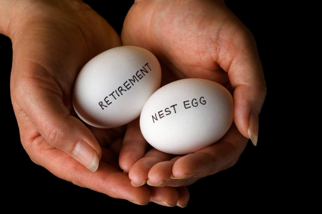 hands holding two eggs with retirement and nest egg written on it