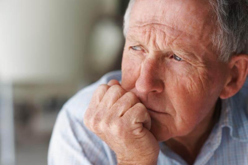 senior man looking thoughtful